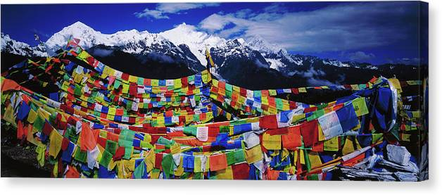 Chinese Culture Canvas Print featuring the photograph Buddhist Prayer Flags With Meili by Richard I'anson