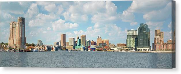 Downtown District Canvas Print featuring the photograph Baltimore Skyline And Inner Harbor by Greg Pease