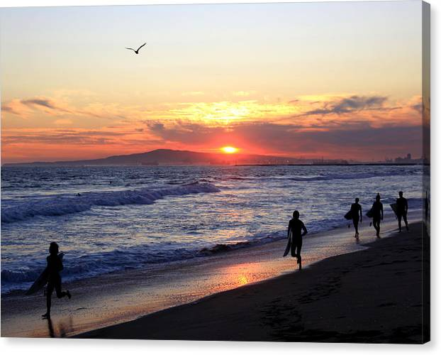 Surfers Canvas Print featuring the photograph Surfers At Sunset by Frank Freni