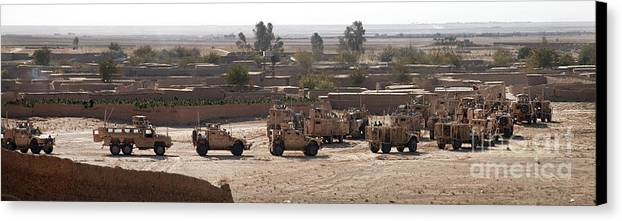 Operation Enduring Freedom Canvas Print featuring the photograph Military Vehicles Parked Outside Loy by Stocktrek Images