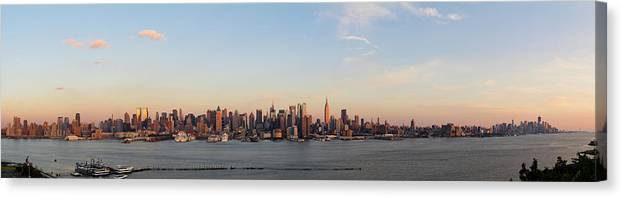 Lower Manhattan Canvas Print featuring the photograph Panoramic View Of Manhattan At Sunset by Chrisp0