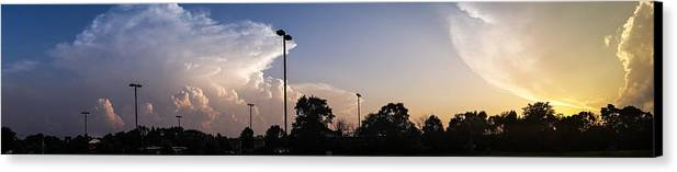 Clouds Canvas Print featuring the photograph Cloud Wars by Lauri Novak