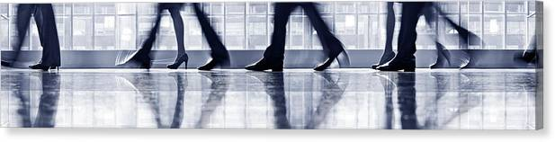 Corporate Business Canvas Print featuring the photograph Businesspeople Walking In Lobby, Low by Poba