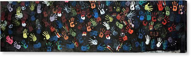 Child Canvas Print featuring the photograph A Painting Of Colorful Handprints by Khananastasia