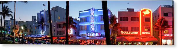 Panoramic Canvas Print featuring the photograph Art Deco Hotels On Ocean Drive At Dusk by Buena Vista Images