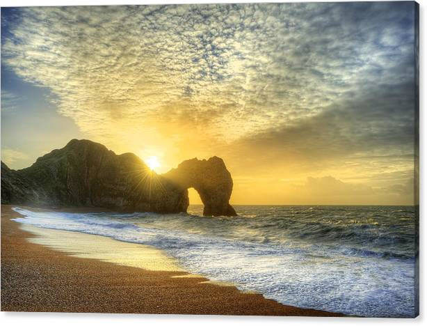 Vibrant sunrise over ocean with rock stack in foreground by Matthew Gibson