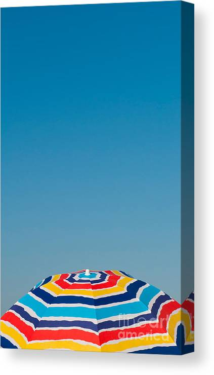 Beach Canvas Print featuring the photograph Beach Umbrella by Luis Alvarenga