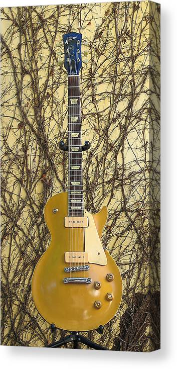 Gibson Les Paul Guitar Canvas Print featuring the photograph Gibson Les Paul Gold Top '56 Guitar by Phyllis Tarlow