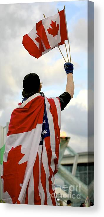 Canada Canvas Print featuring the photograph Waving The Flag by Chris Dutton