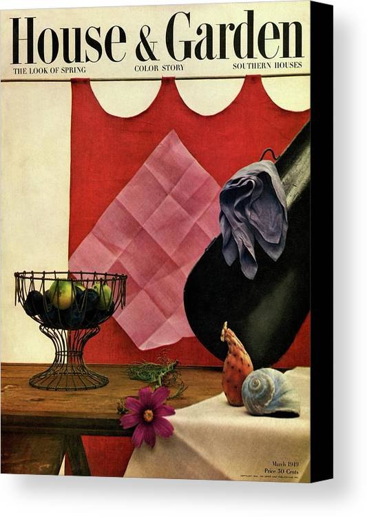 House And Garden Canvas Print featuring the photograph A Wire Basket On A Wooden Table by John Rawlings