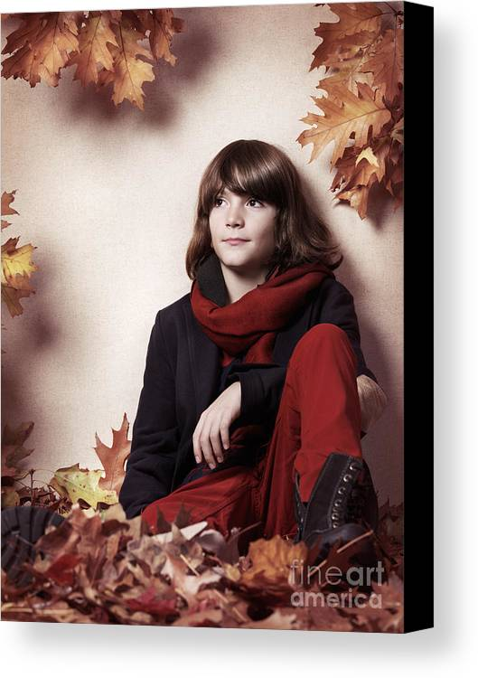 Boy Canvas Print featuring the photograph Boy Sitting On Autumn Leaves Artistic Portrait by Oleksiy Maksymenko