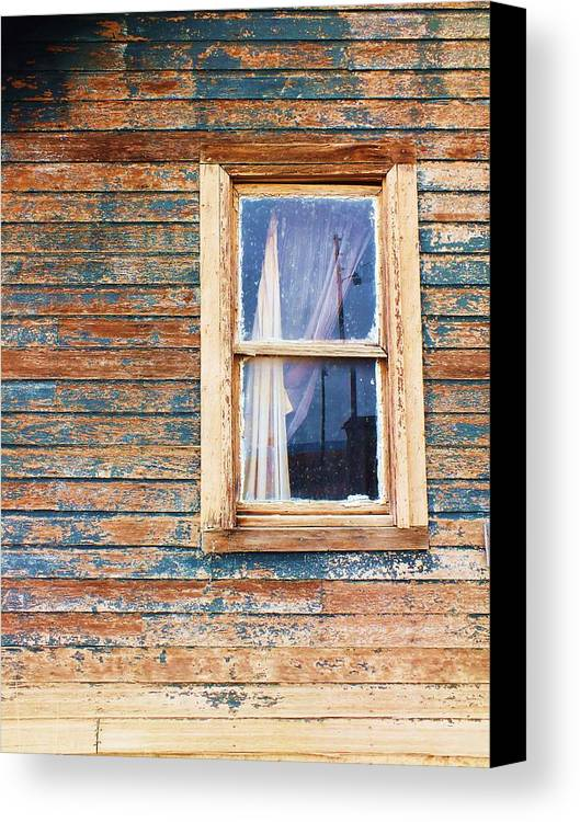 Tattered Canvas Print featuring the photograph Tattered by Anna Villarreal Garbis