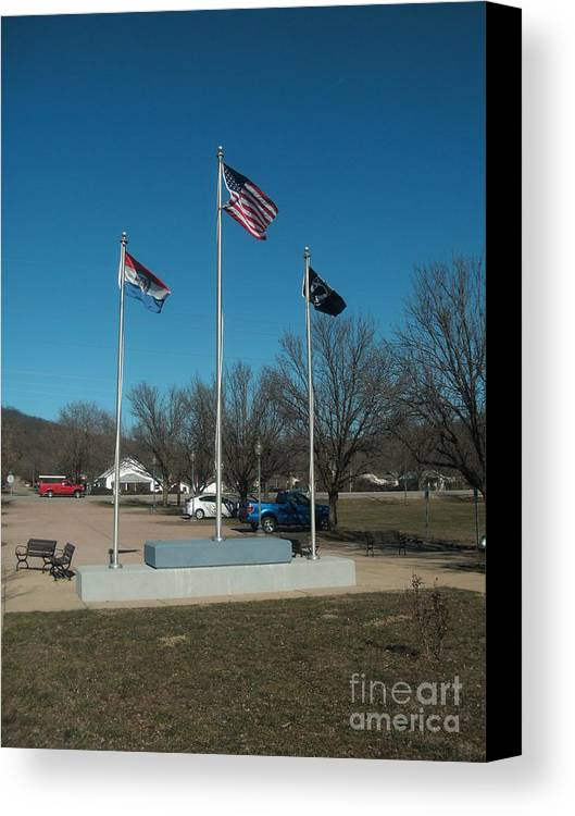 Flag Canvas Print featuring the photograph Flags With Blue Sky by Kip DeVore