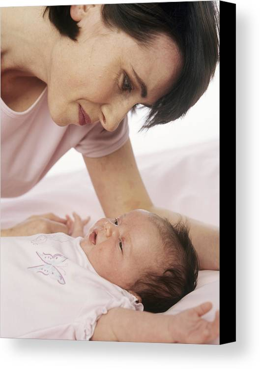 Human Canvas Print featuring the photograph Mother And Baby by Ian Boddy
