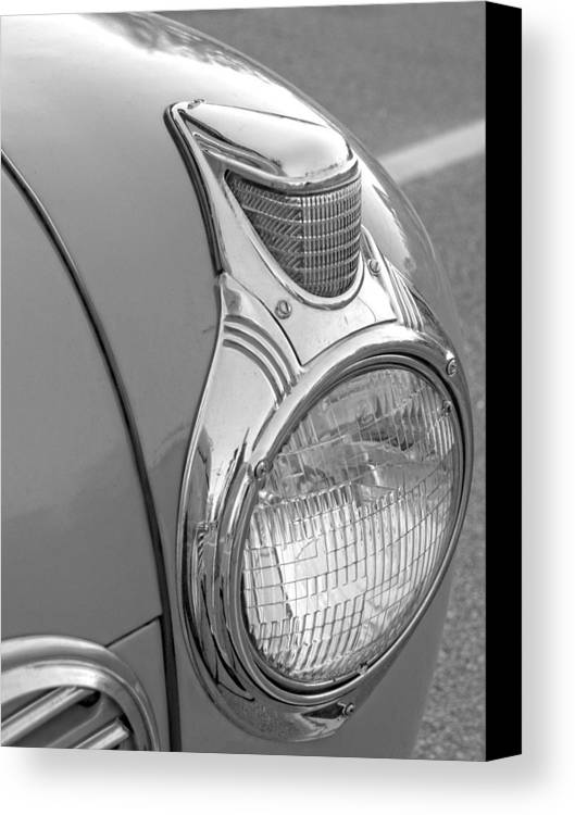 Car Shows Canvas Print featuring the photograph Fancy Headlight by Brian Mollenkopf