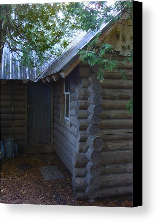 Log Cabin Canvas Print featuring the photograph Logs by Ramie Liddle