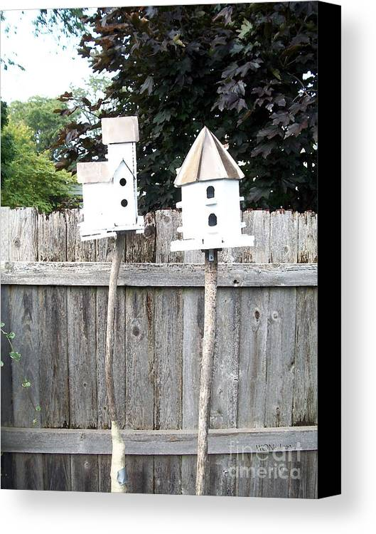 Birds Canvas Print featuring the photograph 2 Bird Houses And A Fence by Walter Oliver Neal