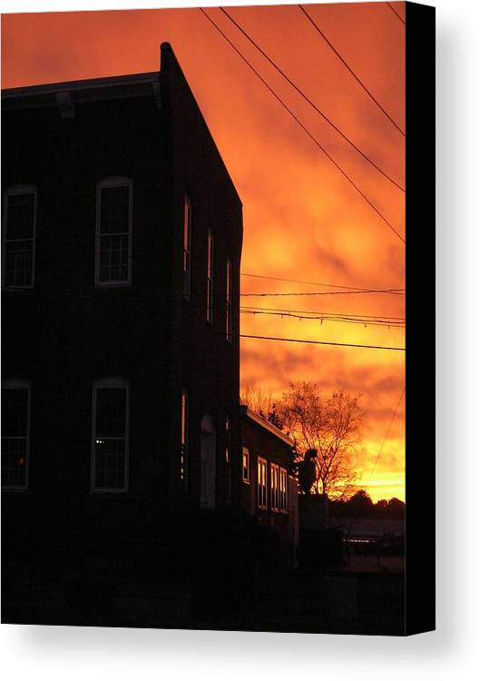Orange Sky Canvas Print featuring the photograph Millyard Sunset by Nancy Ferrier