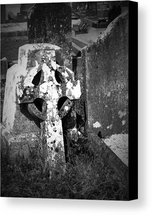 Celtic Canvas Print featuring the photograph Rugged Cross At Fuerty Cemetery Roscommon Ireland by Teresa Mucha
