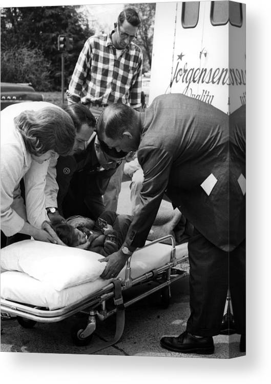 Ambulance Canvas Print featuring the photograph Ambulance Personnel Placing Girl Gurney April by Mark Goebel