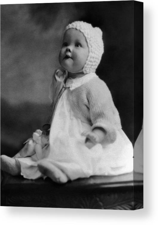 Baby Canvas Print featuring the photograph Baby Wearing Sweater Cap 1920s Black White Boy by Mark Goebel