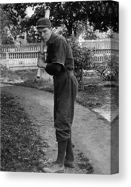 Boy Canvas Print featuring the photograph Boy In Baseball Uniform Posing Bat Circa 1898 by Mark Goebel