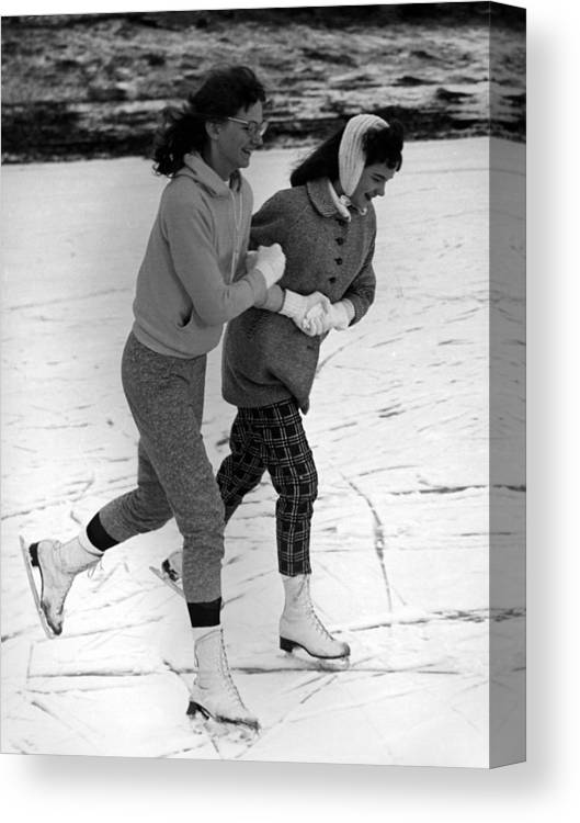 Girls Canvas Print featuring the photograph Girls Ice Skating Circa 1960 Black White 1950s by Mark Goebel