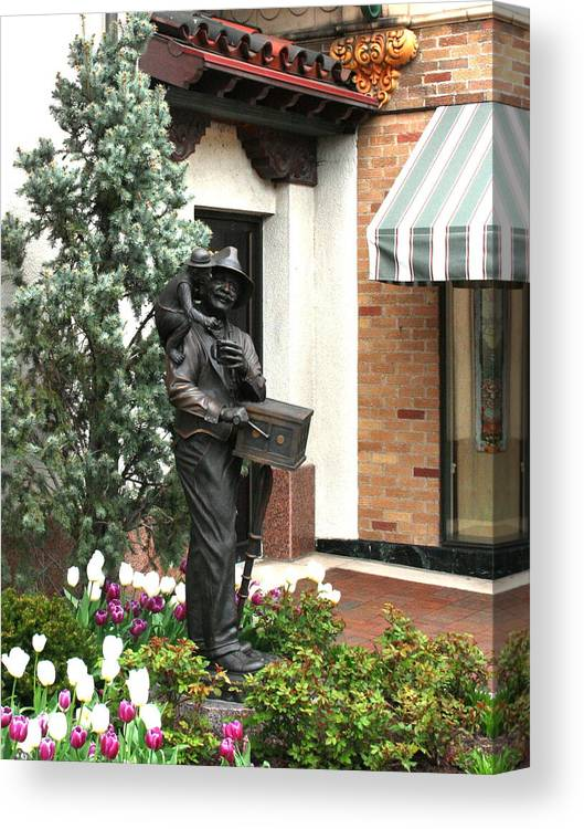Statue Canvas Print featuring the photograph The Organ Grinder Kansas City Missouri by David Dunham