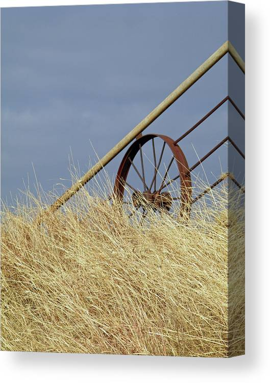 Wagon Wheel Canvas Print featuring the photograph Wagon Wheel Fence by Gale Cochran-Smith