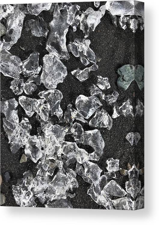 Ice Canvas Print featuring the photograph Ice Pattern On Black Sand by Norman Burnham