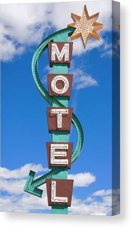 In A Row Canvas Print featuring the photograph Classic Motel Sign by Elementalimaging