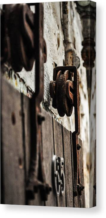 Door Canvas Print featuring the photograph Rusty Wheel by Terepka Dariusz