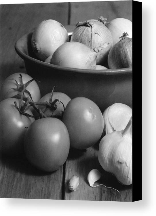Cooking Canvas Print featuring the photograph Tomatos Onion And Garlic by Henry Krauzyk