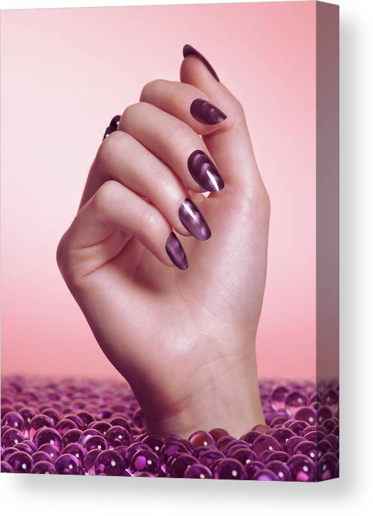 Manicure Canvas Print featuring the photograph Woman Hand With Purple Nail Polish by Oleksiy Maksymenko