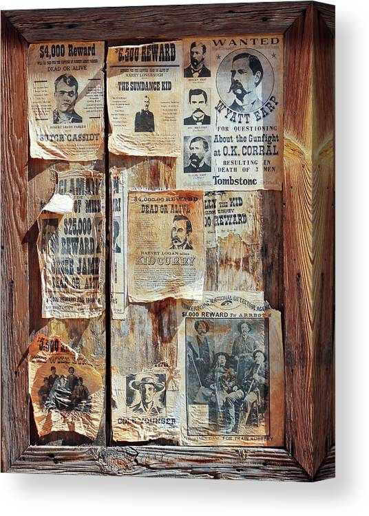 History Canvas Print featuring the photograph A Wooden Frame Full Of Wanted Posters by Derrick Neill