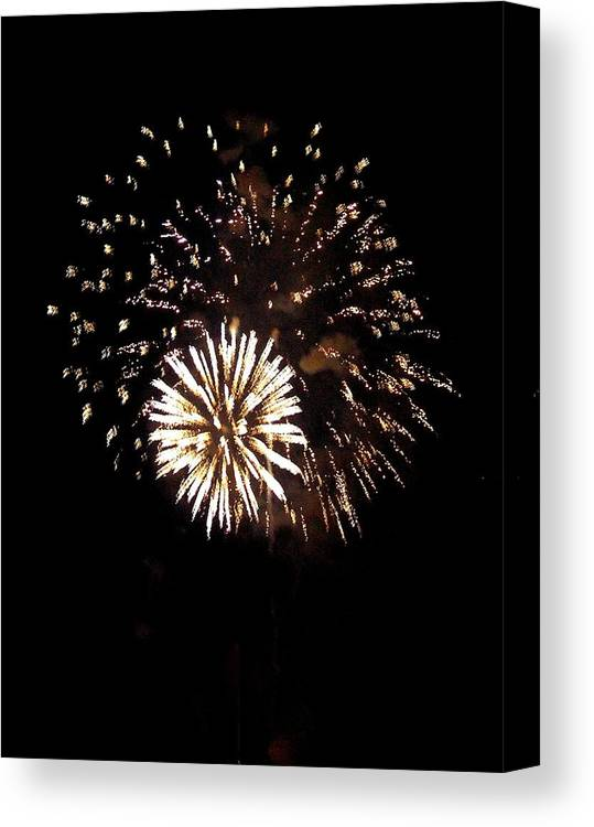 Fireworks Canvas Print featuring the photograph July 4th Fireworks by Jeanette Oberholtzer