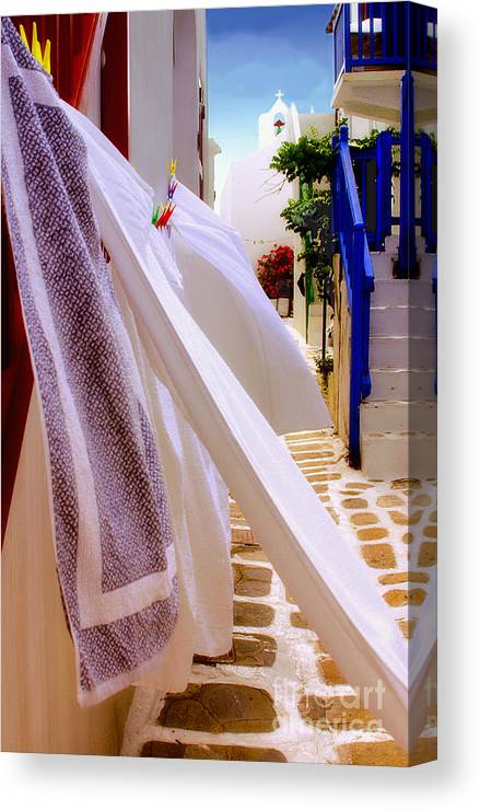 Mykonos Canvas Print featuring the photograph Blowing In The Wind by Madeline Ellis