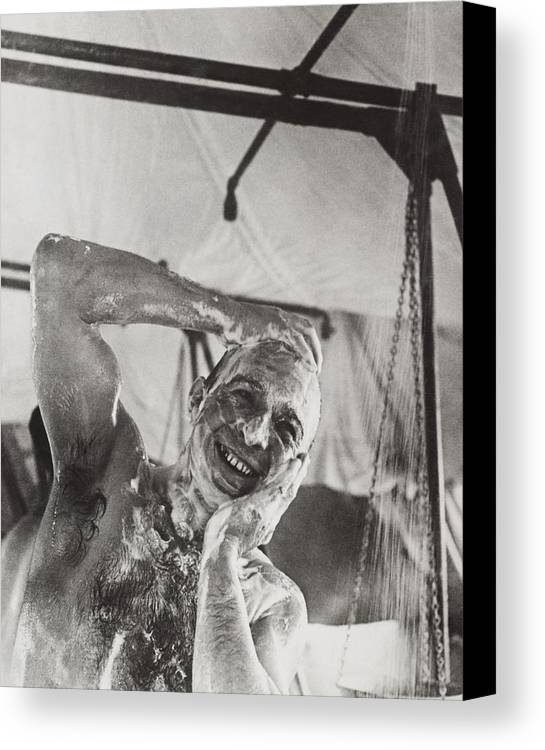 History Canvas Print featuring the photograph British Soldier In The Western Showers by Everett