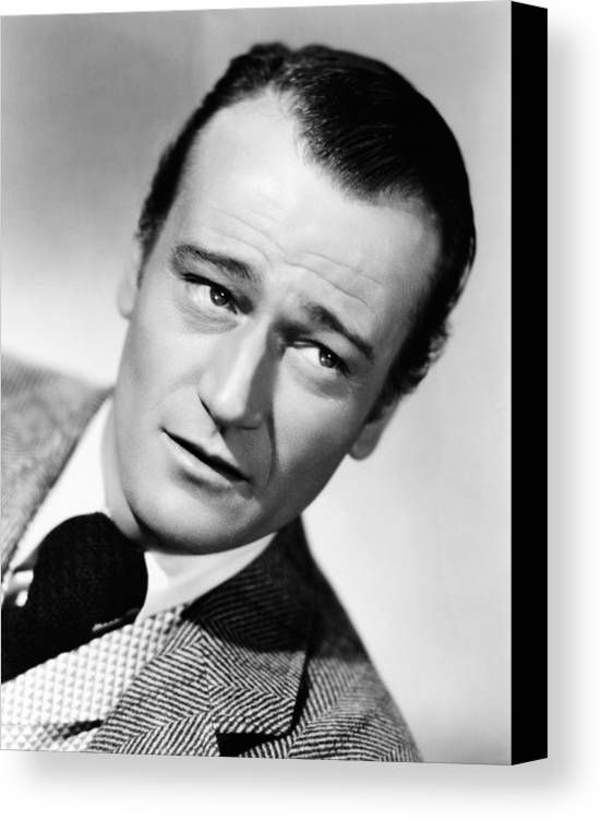 1940s Movies Canvas Print featuring the photograph The Spoilers, John Wayne, 1942 by Everett