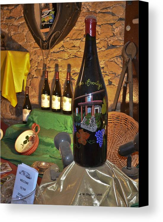 Wine Canvas Print featuring the photograph Wine Bottle On Display by Allen Sheffield