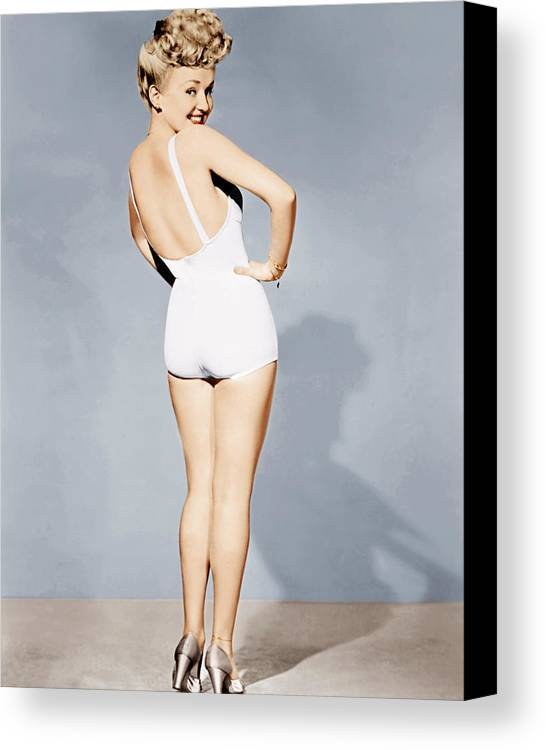 1940s Portraits Canvas Print featuring the photograph Betty Grable, World War II Pin-up, 1943 by Everett