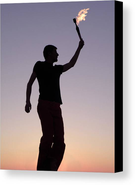 Man; Silhouette; Torch; Flame; Revolution; Champion; Winner; Victory; Victorious; Win; Politics; Political; Speach; Leadership; Idea; Ideas; Future; Sports Canvas Print featuring the photograph The Signal by Gerard Fritz