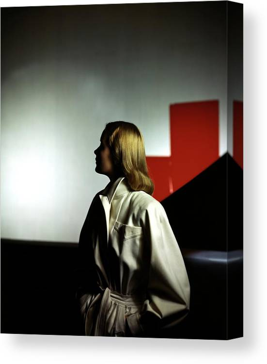 Fashion Canvas Print featuring the photograph A Model Wearing A White Coat by Horst P. Horst