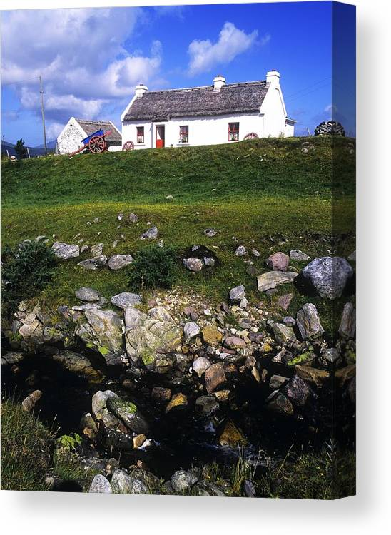 Travel Destination Canvas Print featuring the photograph Cottage On Achill Island, County Mayo by The Irish Image Collection