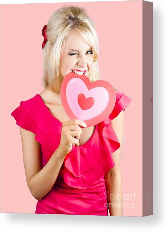 Heart Canvas Print featuring the photograph Cute Woman Biting Big Red Love Heart by Jorgo Photography - Wall Art Gallery