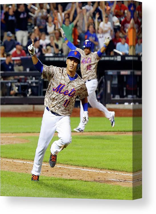 Scoring Canvas Print featuring the photograph Juan Lagares And Ruben Tejada by Jim Mcisaac