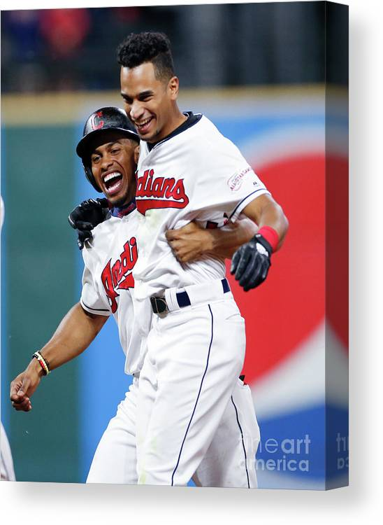 Three Quarter Length Canvas Print featuring the photograph Raisel Iglesias And Francisco Lindor by Ron Schwane