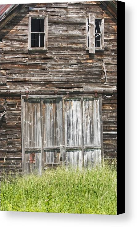 Barn; Building; Old; Old Barn; Maine; Abandoned; Maine Barns; Old Building; Obsolete; Beaten Up; Farm; Old Buildings Maine; Old Door; Weathered Door; Country Living; Farming; Building Exterior; Architecture; Shed; Wood Shingles; Structure; Window; Door; Weathered; Country; Rural; Rustic; Grass; Sunny; Wood; Siding; Spring; New England; Maine Buildings; Old Barns; Rustic Building; Abandoned Buildings Canvas Print featuring the photograph Old Barn In Maine by Keith Webber Jr