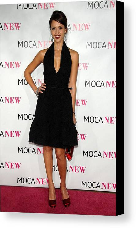 Jessica Alba Canvas Print featuring the photograph Jessica Alba Wearing A Prada Dress by Everett