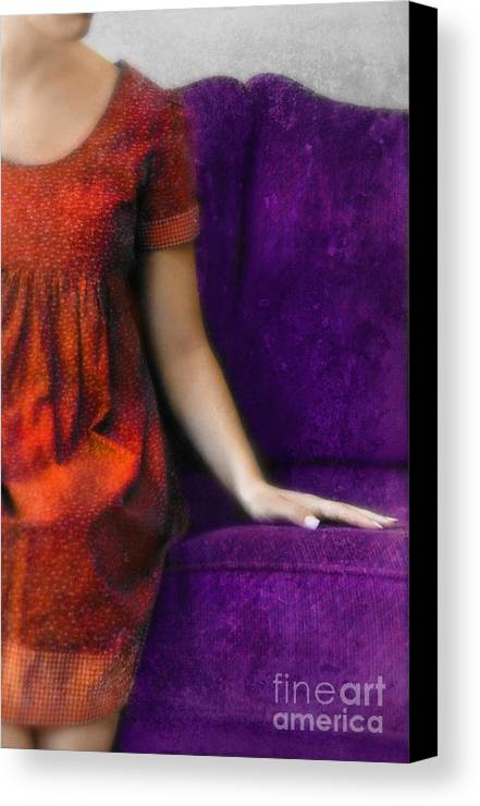 Woman Canvas Print featuring the photograph Young Woman In Red On Purple Couch by Jill Battaglia